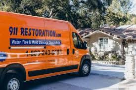 sewage backup cleanup van arriving at residence