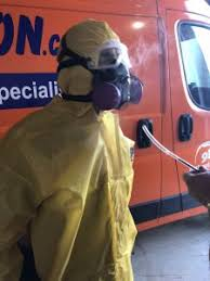 disaster restoration technicians in hazmat suits